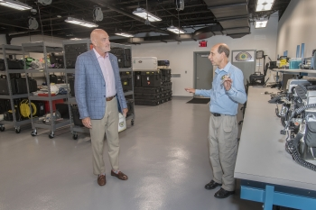 NNSA Associate Administrator and Deputy Under Secretary for Counterterrorism and Counterproliferation Jay Tilden receives a tour of the Brookhaven National Laboratory facility from RAP 1 Regional Equipment Manager Paul Philipsberg.
