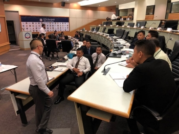 ASEANTOM exercise participants discuss the training during a breakout session.
