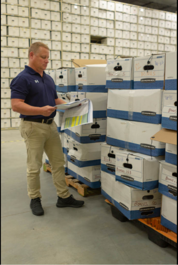 Cliff Carpenter, BONUS LM Site Manager, reviews catalogued records at the Legacy Management Business Center.