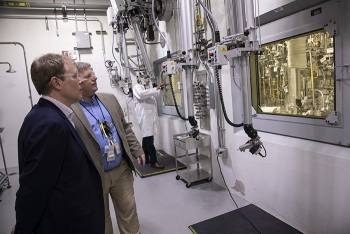 Ike White, left, Senior Advisor for EM, tours the Salt Waste Processing Facility (SWPF) with Cliff Conner, cognizant system engineer and process manager for Parsons, EM's SWPF contractor at the Savannah River Site.