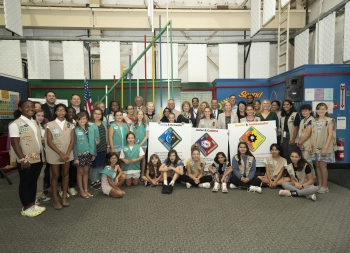 "Elected officials, Girl Scouts of Suffolk County's Board of Directors, Girl Scouts of Suffolk County President Yvonne Grant, Girl Scout ""shooting stars,"" and Brookhaven Lab staff celebrated the new patch program with a launch event on Thursday, Sept. 12."