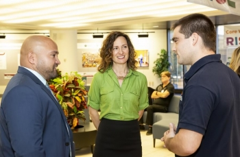 Shannon Swilley Greco, Science Education program leader, chats with  John Martinez, Apprenticeship and Training Representative, U.S. Department of Labor (left), and Kevin Purdy Jr., Apprentice in the program.