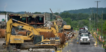 Workers remove debris from the sites of the K-131 and K-631 demolitions at the East Tennessee Technology Park.