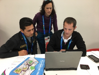 NNSA Scientist Nathan Hoteling explaining the mapping software to a Peruvian National Police member with the assistance of an interpreter.
