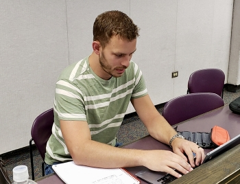 Daniel Walker works on an assignment at Idaho State University. While a Fluor Idaho intern, Walker responded to the information technology needs of computer users and even developed an app.