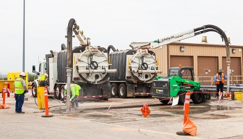 Workers dig a trench for a new fire suppression loop at the Waste Isolation Pilot Plant.