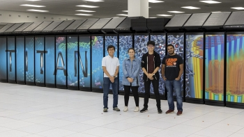 Four of the seven featured ADW 2019 interns are shown in front of Titan (left to right): Shuto Araki, Emily Costa, Yuya Kawakami, and Sajal Dash.