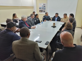 Technical teams from the Peruvian National Police and NNSA meet to coordinate the nuclear security plan.
