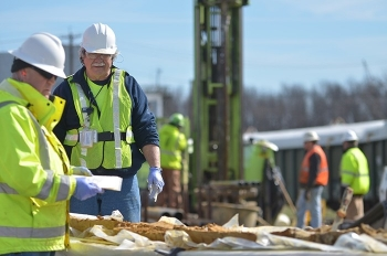 Geologists Rob Flynn, left, and Ken Davis examine core samples used to determine the location of the wells to optimize pump-and-treat operations at the Paducah Site's northeast groundwater contamination plume.