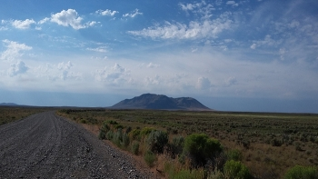 A tour for DOE representatives and others at the Idaho National Laboratory Site stopped to view Big Southern Butte, which holds spiritual significance for the Shoshone-Bannock Tribes.