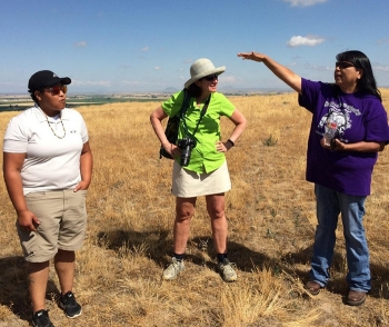 From left, Talia Martin with Shoshone-Bannock Tribes, Melissa Thibault with 100Kin10, and LaRae Bill with the Shoshone-Bannock Tribes discuss the topography of the land and its rivers during the Idaho National Laboratory Site tour.
