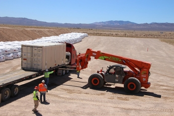 The final Clean Slate III shipment is lifted off a truck for permanent disposal at the Nevada National Security Site Area 3 Radioactive Waste Management Site.