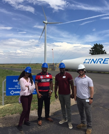 FEMP veterans standing in front of a wind turbine at the National Renewable Energy Laboratory.