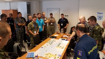NNSA partnered with NATO to complete its first-ever Maritime Pilot course. Here, small work groups tackle maritime planning operations during a tabletop exercise.