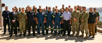 NNSA partnered with NATO to complete its first-ever Maritime Pilot course. Course participants pose for a group photo at Souda Bay Naval Base in Greece