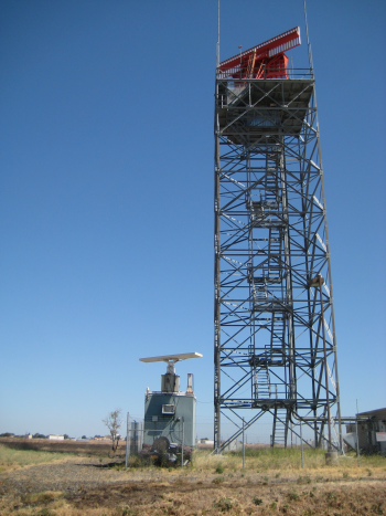 radar tower against a blue sky.