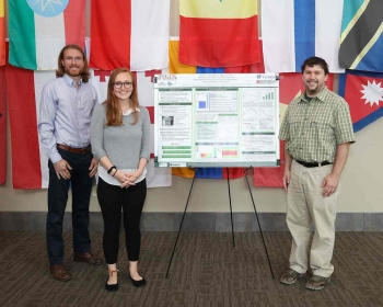 Kaylee Cunningham, center, earned Best Poster honors at the summer 2019 NESLS poster session. Here she is joined by her mentors, Robert Lefebvre, left, and Jeffrey Powers.