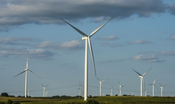 Many wind turbines on a field in Iowa.