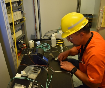 Electrician Nathan Klebaum installs fiber optic cables inside an electrical powerhouse for the Effluent Management Facility at EM Hanford's Waste Treatment and Immobilization Plant.