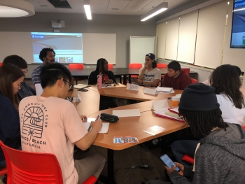 Harold Washington College students discuss the Community College Internship with Fermilab representatives.