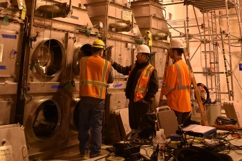 From left, Robert Sprague with Waste Treatment Completion Company, and Zach Phillips and Bill Trainor from Mississippi State University (MSU) test high-efficiency particulate air filters at Hanford's Waste Treatment and Immobilization Plant.