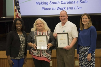 S contractors are presented with the Palmetto Shining Star Award on June 21.