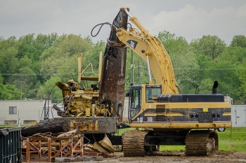 Four Rivers Nuclear Partnership Heavy Equipment Operator Brad Langston downsizes a decommissioned crane at the C-740 Material Yard.