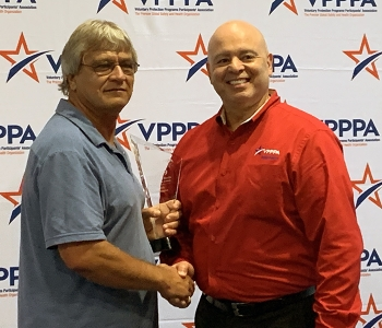 Billy Ellington, left, receives the 2019 Safety and Health Outreach Award from J.A. Rodriguez, chair of the DOE Voluntary Protection Programs Participants' Association National Board of Directors.