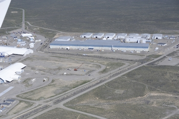Under a proposed strategy, the Transuranic Storage Area/Retrieval Enclosure, which is the large gray building pictured here, would become the first building to be closed at the Advanced Mixed Waste Treatment Project at DOE's Idaho National Laboratory Site