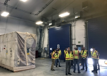 Crews resized gloveboxes containing waste and other large debris after opening 12-foot-high waste boxes from laboratories at EM's former Mound Site in Ohio.