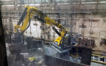 "A new robotic arm was installed at the Advanced Mixed Waste Treatment Project to provide more ""muscle"" in waste resizing operations."