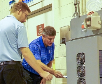 Savannah River Remediation (SRR) President and Project Manager Tom Foster, right, and SRR Senior Industrial Hygienist Alex Brown view a system that monitors air quality for potentially dangerous mercury vapors.