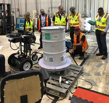 Fluor Idaho deployed a system to characterize the contents of some containers at the Advanced Mixed Waste Treatment Project by measuring their dimensions and entering them into a computer program.