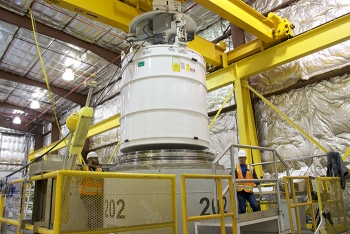 Advanced Mixed Waste Treatment Project crews prepare a transportation cask containing waste for shipment to EM's Waste Isolation Pilot Plant.
