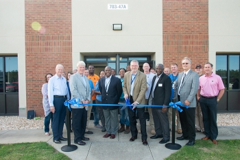 """Savannah River Site federal and contractor employees gather for a ribbon cutting for a """"one-stop shop"""" for employee onboarding at Savannah River Nuclear Solutions (SRNS)."""
