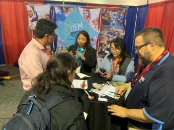Staff engage students at the AISES conference.