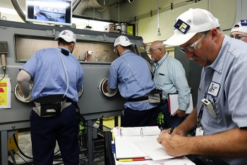 Workers at Oak Ridge install new gloveboxes to begin processing a portion of uranium-233 a year ahead of schedule.
