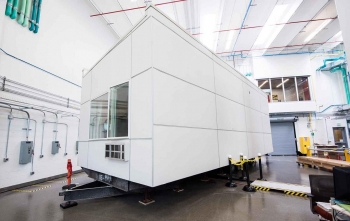 NREL's iUnit is a modular apartment that can be moved indoor for guarded testing or outdoor for environmental testing. NREL is using iUnit to conduct validation-grade energy simulation experiments.
