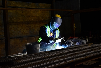 It may be dark outside, but a welder on the night shift at Hanford's Waste Treatment and Immobilization Plant is creating sparks as he welds rebar.