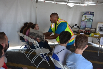 Marc Hill with EM contractor Fluor-BWXT provides a demonstration on historic preservation at the Science Alliance event.
