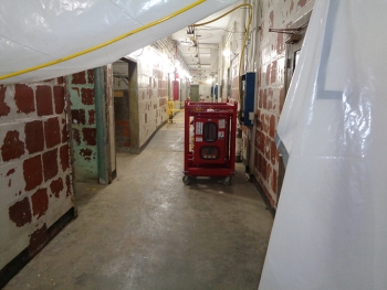 Photos show a hallway in the Biology Complex before, at top, and after Oak Ridge crews completed asbestos abatement.