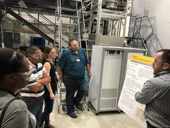 Molten Salt Reactor Experiment (MSRE) System Engineer Melanie Lindsey, third from left, leads delegates from the Nuclear Regulatory Commission and Ontario Power Generation on a tour of the reactor test loop and reactor corrosion laboratory at Oak Ridge.