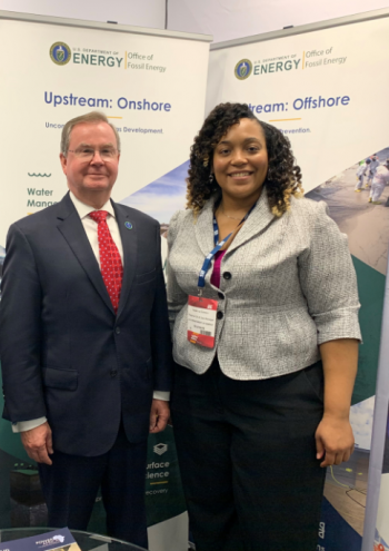MLEF Graduate Natenna Dobson pictured with Assistant Secretary for Fossil Energy Steven Winberg at Africa Oil Week 2019