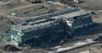 Photos of the Plutonium Finishing Plant's main processing facility from November 2018, at top, and after the completion of lower-risk demolition last week highlight progress since demolition activities resumed in September 2018 with enhanced safety contro
