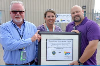 From left, Pete Coutts, Portsmouth plant manager; Tara Warren, Portsmouth logistics manager; and Jeremy Bates, Portsmouth facility manager and Voluntary Protection Program (VPP) coordinator, show their VPP Star certificate.