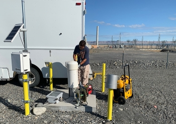 Juan Aguilar with Hanford contractor CH2M HILL Plateau Remediation Company prepares to take a groundwater sample from a well at a soil treatability test site in Hanford's 100 K Area.