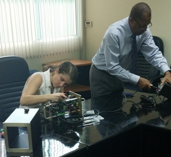 Emily Jackson and James Butler from NNSA's Remote Sensing Laboratory adjust SPARCS equipment in Thailand.
