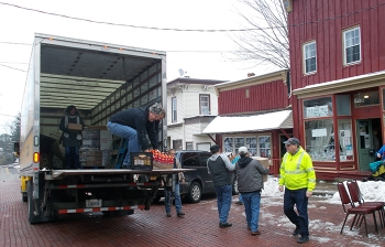 Volunteers in the West Valley Demonstration Project's annual food drive deliver 44 turkeys and other items to a food pantry in Cattaraugus, New York.