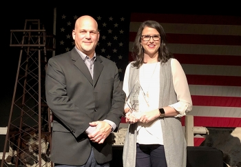 UCOR Safety & Health Operations Manager Chris Thursby and UCOR Chief of Staff Ashley Saunders accept an award as one of America's Safest Companies for their work conducting environmental cleanup in Oak Ridge.