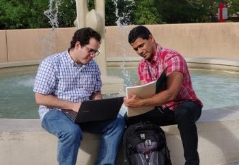 Edgardo Desarden Carrero, right, talks with Melvin Lugo Alvarez, both summer interns from the University of Puerto Rico, Mayagüez, studying resilient energy systems at Sandia National Laboratories.